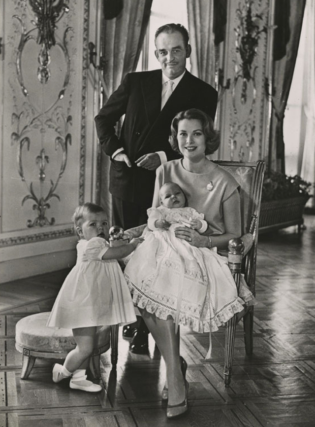Prince Rainier of Monaco holding his daughter Caroline, while his wife Grace holds their baby son Albert, 1960
