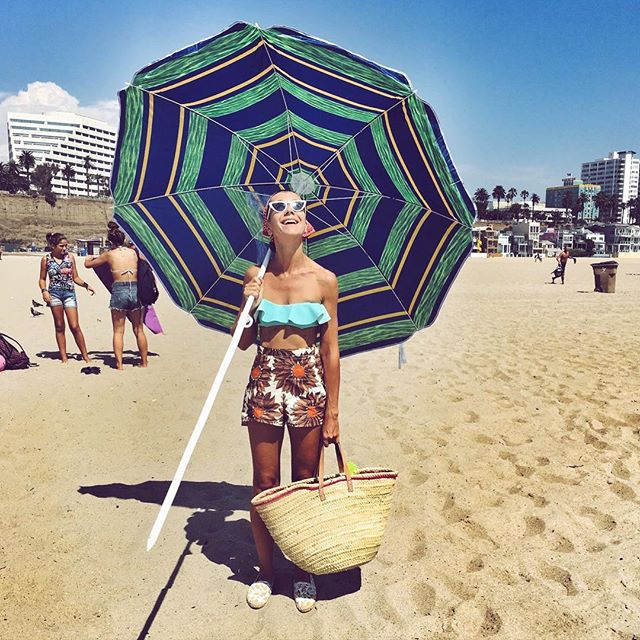 I paid someone a dollar for this umbrella   #beach #heatwave #summer #santamonica #parasol #umbrella #sunny #beachbag #bikini #vintage #floral #shorts