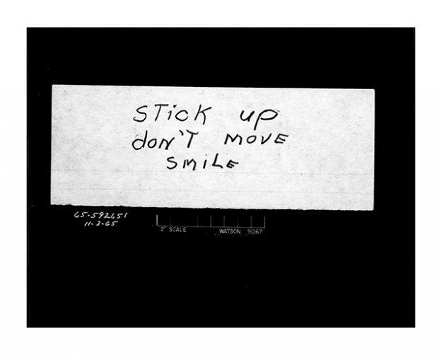 """Stick up don't move smile"" Bank robbery note. Date: 11/3/1965 Photographer: Unknown"