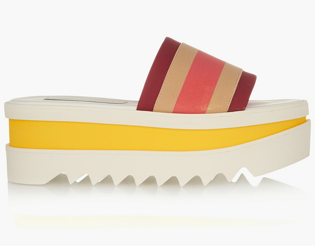 "Stella McCartney<p><a target=""_blank\"" href=\""https://www.net-a-porter.com/ua/en/product/645258/stella_mccartney/striped-faux-leather-and-canvas-platform-slides\"">net-a-porter.com</a></p>"